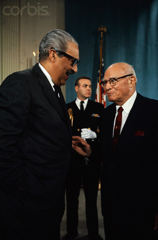 11 Apr 1969, Washington, DC, USA --- Original caption: Representative Emanuel Celler of New York chats with Supreme court Justice Thurgood Marshall after president Johnson signed the Civil Rights Bill into law.