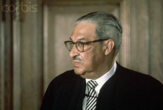 20 Apr 1972, Washington, DC, USA --- Thurgood Marshall (1908-1993), first African American member of the United States Supreme Court stands wearing his robes. Among the many cases Marshall successfully argued, one of the most well known was Brown v. Topeka Board of Education in which racial segregation in American public schools was declared unconstitutional. Washington, D.C.