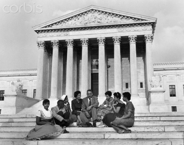 22 Aug 1958, Washington, DC, USA --- Original caption: Six black children who attended Little Rock's Central High School earlier in 1958, and two NAACP officials sit outside the Supreme Court in this 8/22/58 photo. The NAACP asked the Supreme Court to take action insuring the admission of the black children when the school opens 9/2/58. From left are : Melva Patillo, 16; Jefferson Thomas, 15; Gloria Ray, 15; Mrs. C. Bates, President of NAACP in Little Rock; Thurgood Marshall, NAACP chief counsel; Carlotta Walls, 15; Minnie Jean Brown, 16; and Elizabeth Edkford, 16.