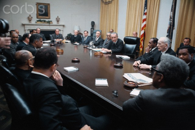 05 Apr 1968, Washington, DC, USA --- Original caption: President Johnson called top Negro and Government leaders to the White House for urgent talks on racial tensions erupting from the slaying of Dr. Martin L. King. Clockwise around table starting at left are Bishop George Baber; Whitney Young; Vice President Humphrey; Roy Wilkins, (hidden behind Humphrey); HUD Secretary Robert Weaver; Clarence Mitchell III; Secretary of Defense Carl Clifford; Senator Thomas Kuchel; R-Calif.; Rep. William H. McCulloch, R-Ohio; Rep. Carl Albert, House Democratic leader; Sen. Mike Mansfield, Senate Majority leader; Supreme Court Justice Thurgood Marshall, (partially hidden); and President Johnson. Behind Rep. Albert is Mayor Walter Washington of Washington, D.C., in conversation with Nicholas Katzenbach, Undersecretary of State.