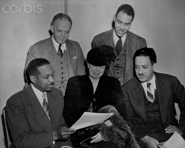 Eleanor Roosevelt and Dr. James McClendon, board members of the NAACP, go over the 1947 program with NAACP executive officers Walter White and Roy Wilkins as Thurgood Marshall looks on.
