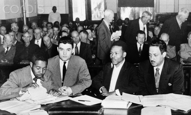 Seated in the crowded courtroom during the second trial of Walter Lee Irvin (Third from Left) are, Left to Right: Paul C. Perkins; Jack Greenberg, New York attorney for the NAACP; Irvin; and Thurgood Marshall, chief counsel for the NAACP. Irvin was sentenced to die in the electric chair after being found guilty on a charge of rape. Irvin is one of the four Negroes charged with kidnapping a young Florida housewife anf raping her.