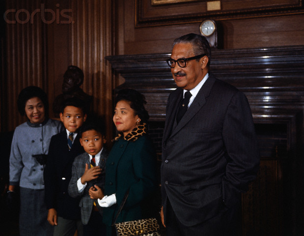 Thurgood Marshall stands with his family prior to being sworn in as the first black member of the U.S. Supreme Court. Left to right are his sister-in-law, Mrs. Sally Acoba; sons, Thurgood, Jr., and John, 9; and wife, Cecilia.