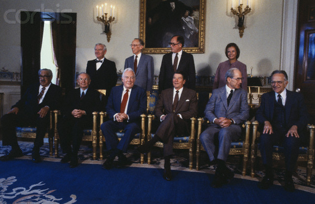 Washington, D.C.: United States President Ronald Reagan poses for a formal portrait with the judges of the United States Supreme Court. From left to right (standing) are: John Paul Stevens; Lewis. F. Powell, Jr.; William H. Rehnquist and Sandra Day O'Connor. Seated are: Thurgood Marshall; William J. Brennan, Jr.; Chief Justice Warren Burger; President Reagan; Byron White and Harry Blackmun.