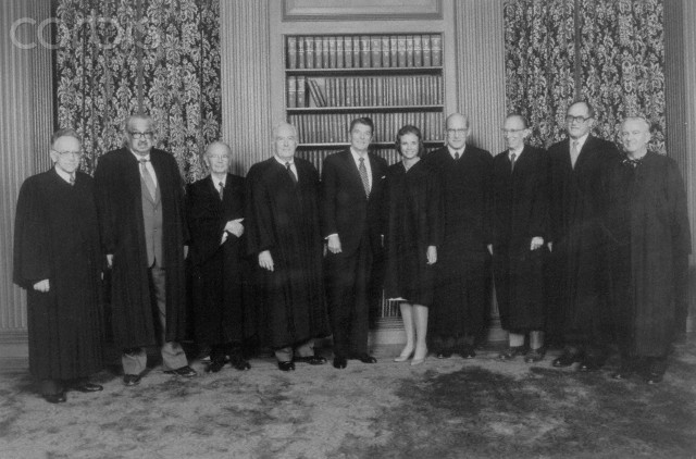 25 Sep 1981, Washington, DC, USA --- The Supreme Court Justices pose with the President in the Supreme Court conference room. From left are Justices Harry Blackmun, Thurgood Marshall, William Brennan, Warren Burger, the President, Justice Sandra O'Connor, Justices Byron White, Lewis Powell, William Rehnquist and John Paul Stevens.