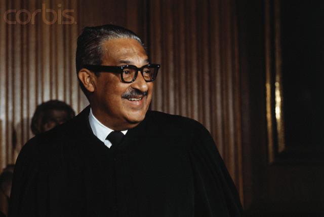 "Associate Supreme Court Justice Swear In. Thurgood Marshall in his robe prior to being sworn in as the first Negro member of the U. S. Supreme Court, October 2nd. Marshall, the great-grandson of a slave, swore to ""do equal right to the poor and the rich"" as he took the oath at the opening session of the court."