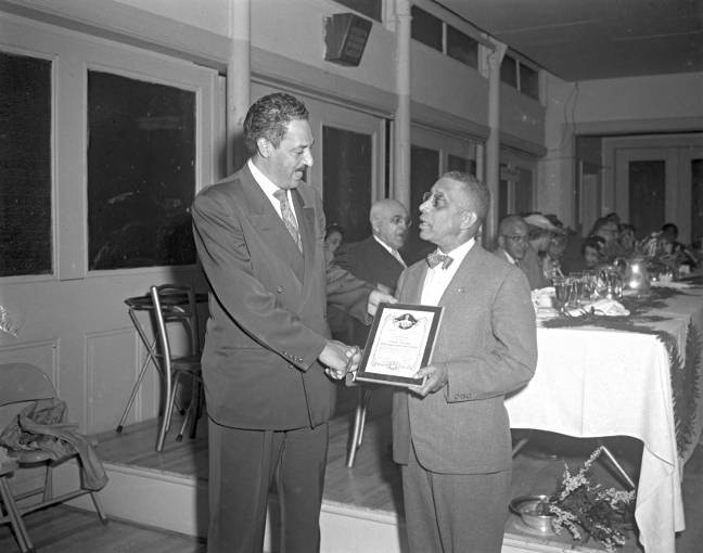 THURGOOD MARSHALL RECEIVING NAACP PLAQUE FROM CARL MURPHY, CA. 1956. PAUL HENDERSON