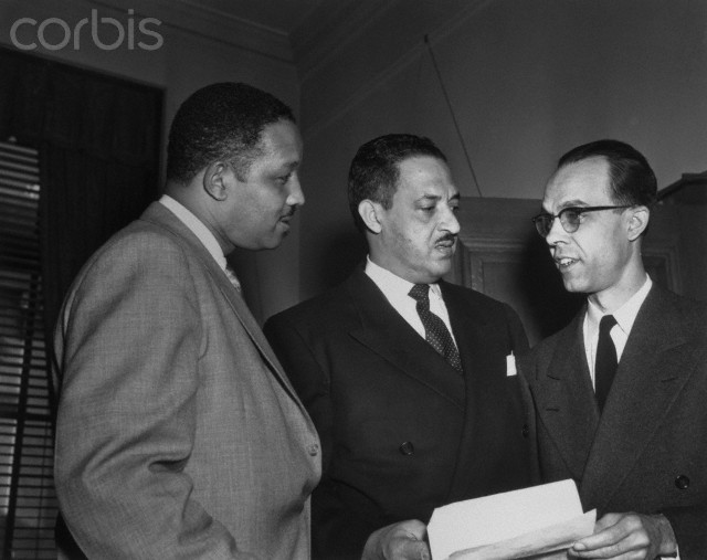 "07 Dec 1953, Washington, DC, USA --- Original caption: Negro attorneys Harold R. Boulware (L), Columbia, S.C., and Spotswood Robinson III (R), who are arguing against segregation before the Supreme Court, discuss their strategy during the first day (Dec. 7th) of the historic two-day hearings on the issue. Robinson and Marshall led off for the National Association for the Advancement of Colored People (NAACP), urging the High Court to end racial segregation in the public schools and wipe out ""a sorry heritage of slavery."" The cases of four states and the District of Colombia are under consideration."