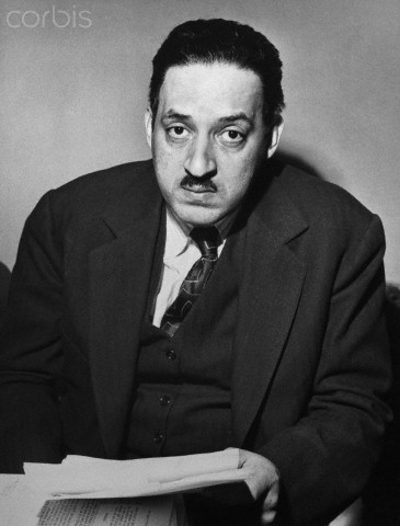Thurgood Marshall, attorney for the NAACP, seated holding a paper.