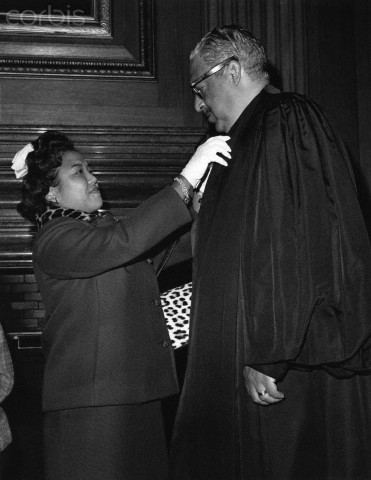 Thurgood Marshall gets a last minute check from his wife, Cecilia Suyat, before his swearing in at the Supreme Court in 1967. Marshall was the first African American justice in the Supreme Court's 178-year history. Marshall is wearing the robe he used when he was judge in New york City's Second District Court of Appeals.