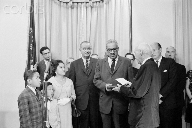 Thurgood Marshall, first Negro to become U.S. Solicitor General, sworn in by President Johnson. Marshall introduces President Johnson to Mrs. Marshall and their sons Thurgood, Jr., 9 and John, 7 after taking his oath in a White House ceremony. Center background is Paul Bender, Assistant to the Solicitor General.