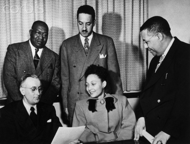 Mrs. Ada Lois Sipuel, a Negro, is shown applying for admission to the Univ. of Oklahoma School of Law, after a long legal struggle culminating in a U.S. Supreme Court decision ordering the school to accept her. Reading the transcript of her record at Langston University is J.E. Fellows of the univ. office of admission and records. In rear are D.H. Williams of the Oklahoma AACP; Thurgood Marshall, NY attorney for NAACP; and Amos Hall, State Representative from Tulsa. (ORIGINAL CAPTION)