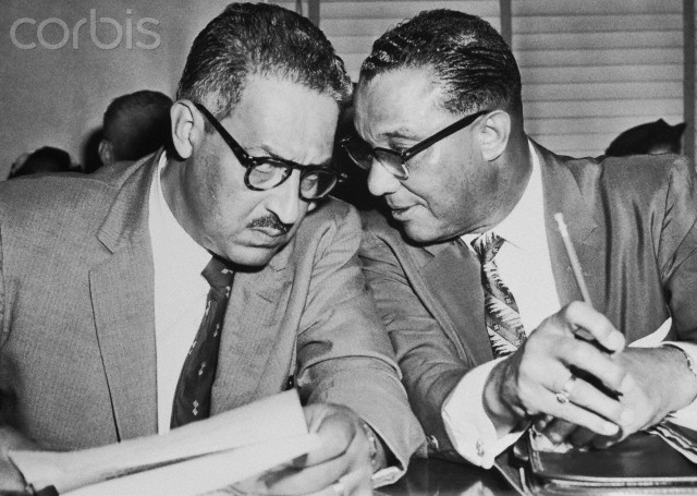 "W.J. Durham (R), attorney for the NAACP, talks with Thurgood Marshall, the organization's chief counsel, in Federal Court. The NAACP has petitioned the court to order immediate integration in the schools of Dallas. The city's school board has asked for a delay in integration past the 1959-1960 school year because ""each day that passes lessens the chance of violence."""