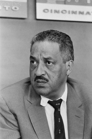 Photo shows Attorney for the NAACP, Thurgood Marshall, (1908-1993), seated.