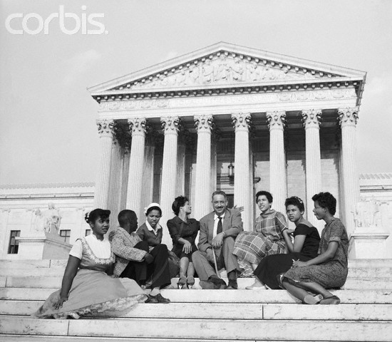 Washington, DC, USA --- Original caption: 5/9/79-Washington: Six black children who attended Little Rock's Central High School earlier in 1958, and two NAACP officials sit outside the Supreme Court in this 8/22/58 photo. The NAACP asked the Supreme Court to take action insuring the admission of the black children when the school opens 9/2/58. from left are : Melba Patillo, 16; Jefferson Thomas, 15; Gloria Ray, 15; Mrs. C. Bates, Pres. of NAACP in Little Rock; Thurgood Marshall, NAACP chief counsel; Carlotta Walls, 15; Minnie Jean Brown, 16; and Elizabeth Edkford, 16.