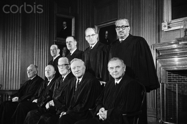 23 Oct 1967, Washington, DC, USA --- Members of the United States Supreme Court. The Court's newest member, Thurgood Marshall (top right), is the first African American to sit on the high tribunal. The justices are (back to front, seated): John Marshall Harlan, Hugo LaFayette Black, Earl Warren, William O. Douglas, and William J. Brennan Jr. Standing (back to front): Abe Fortas, Potter Stewart, Byron R. White, and Thurgood Marshall.